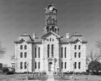 A photo of the Hood County Courthouse in Granbury, Texas.  Designed by W.C. Dodson and built in 1890, the Granbury courthouse continues to host county offices, though most judicial functions have been relocated a few blocks to the west to the Hood County Justice Center, which was completed in 2006.  The limestone Hood County Courthouse, a Second Empire structure, is listed on the National Register of Historic Places and is a Texas Historic Landmark.  This photo © Capitolshots Photography/TwoFiftyFour Photos, LLC, ALL RIGHTS RESERVED.