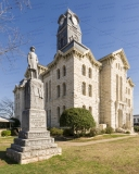 An image of the Hood County Courthouse in Granbury, Texas.  In the foreground is a memorial to Confederate veterans.  Designed by W.C. Dodson and built in 1890, the Granbury courthouse continues to host county offices, though most judicial functions have been relocated a few blocks to the west to the Hood County Justice Center, which was completed in 2006.  The limestone Hood County Courthouse, a Second Empire structure, is listed on the National Register of Historic Places and is a Texas Historic Landmark.  This image © Capitolshots Photography/TwoFiftyFour Photos, LLC, ALL RIGHTS RESERVED.