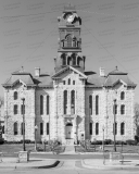 An image of the Hood County Courthouse in Granbury, Texas.  Designed by W.C. Dodson and built in 1890, the Granbury courthouse continues to host county offices, though most judicial functions have been relocated a few blocks to the west to the Hood County Justice Center, which was completed in 2006.  The limestone Hood County Courthouse, a Second Empire structure, is listed on the National Register of Historic Places and is a Texas Historic Landmark.  This image © Capitolshots Photography/TwoFiftyFour Photos, LLC, ALL RIGHTS RESERVED.