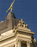 An image of the dome of the Manitoba Legislative Building in Winnipeg.  The dome is topped by Golden Boy, a gold-covered bronze statue sculpted by Georges Gardet.  Designed by Frank Worthington Simon and Henry Boddington III in a Classical Revival style, the Manitoba Legislative Building was completed in 1920.  This image © Capitolshots Photography/TwoFiftyFour Photos, LLC, ALL RIGHTS RESERVED.