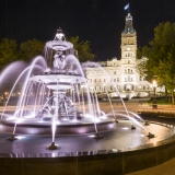 An image of the Quebec Parliament Building at night.  In the foreground is the Fontaine de Tourny, created by sculptor Mathurin Moreau.  The fountain was first inaugurated in Bordeaux, France in 1857 and was revived in Quebec City in 2007.  Designed by Eugene-Etienne Tache, the Quebec Parliament Building (Hotel du Parlement du Quebec), a Second Empire masterpiece, was built in Quebec City between 1877 and 1886.  This image © Capitolshots Photography/TwoFiftyFour Photos, LLC, ALL RIGHTS RESERVED.