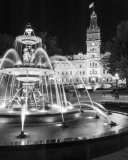 A photo of the Quebec Parliament Building at night.  In the foreground is the Fontaine de Tourny, created by sculptor Mathurin Moreau.  The fountain was first inaugurated in Bordeaux, France in 1857 and was revived in Quebec City in 2007.  Designed by Eugene-Etienne Tache, the Quebec Parliament Building (Hotel du Parlement du Quebec), a Second Empire masterpiece, was built in Quebec City between 1877 and 1886.  This photo © Capitolshots Photography/TwoFiftyFour Photos, LLC, ALL RIGHTS RESERVED.