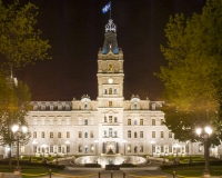 A photo of the Quebec Parliament Building at night.  Designed by Eugene-Etienne Tache, the Quebec Parliament Building (Hotel du Parlement du Quebec), a Second Empire masterpiece, was built in Quebec City between 1877 and 1886.  This photo © Capitolshots Photography/TwoFiftyFour Photos, LLC, ALL RIGHTS RESERVED.