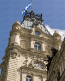 An image of the clock tower, featuring a clock installed by Cyrille Duquet, atop the Quebec Parliament Building (Hotel du Parlement du Quebec).  Designed by Eugene-Etienne Tache, the Quebec Parliament Building, a Second Empire masterpiece, was built in Quebec City between 1877 and 1886.  This image © Capitolshots Photography/TwoFiftyFour Photos, LLC, ALL RIGHTS RESERVED.