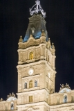 An image of the clock tower, featuring a clock installed by Cyrille Duquet, at night atop the Quebec Parliament Building (Hotel du Parlement du Quebec).  Designed by Eugene-Etienne Tache, the Quebec Parliament Building, a Second Empire masterpiece, was built in Quebec City between 1877 and 1886.  This image © Capitolshots Photography/TwoFiftyFour Photos, LLC, ALL RIGHTS RESERVED.