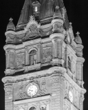 A photo of the clock tower, featuring a clock installed by Cyrille Duquet, at night atop the Quebec Parliament Building (Hotel du Parlement du Quebec).  Designed by Eugene-Etienne Tache, the Quebec Parliament Building, a Second Empire masterpiece, was built in Quebec City between 1877 and 1886.  This photo © Capitolshots Photography/TwoFiftyFour Photos, LLC, ALL RIGHTS RESERVED.