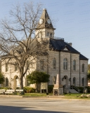 A photo of the Somervell County Courthouse in Glen Rose, Texas.  Designed by John Cormack and constructed in 1893, the limestone Glen Rose courthouse, a Romanesque Revival structure, was renovated in 1987.  The Somervell County Courthouse is listed on the National Register of Historic Places and is a Texas Historic Landmark.  This photo © Capitolshots Photography/TwoFiftyFour Photos, LLC, ALL RIGHTS RESERVED.