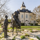 An image of the Somervell County Courthouse in Glen Rose, Texas.  Designed by John Cormack and constructed in 1893, the limestone Glen Rose courthouse, a Romanesque Revival structure, was renovated in 1987.  The Somervell County Courthouse is listed on the National Register of Historic Places and is a Texas Historic Landmark.  This image © Capitolshots Photography/TwoFiftyFour Photos, LLC, ALL RIGHTS RESERVED.