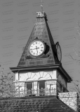 An image of the clock tower of the Somervell County Courthouse in Glen Rose, Texas.  Designed by John Cormack and constructed in 1893, the limestone Glen Rose courthouse, a Romanesque Revival structure, was renovated in 1987.  The Somervell County Courthouse is listed on the National Register of Historic Places and is a Texas Historic Landmark.  This image © Capitolshots Photography/TwoFiftyFour Photos, LLC, ALL RIGHTS RESERVED.