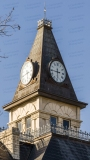 A photo of the clock tower of the Somervell County Courthouse in Glen Rose, Texas.  Designed by John Cormack and constructed in 1893, the limestone Glen Rose courthouse, a Romanesque Revival structure, was renovated in 1987.  The Somervell County Courthouse is listed on the National Register of Historic Places and is a Texas Historic Landmark.  This photo © Capitolshots Photography/TwoFiftyFour Photos, LLC, ALL RIGHTS RESERVED.